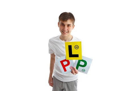 Young male youth holding l an p plates