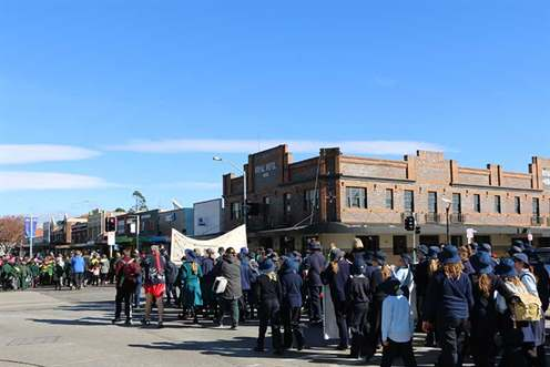 This is an Image of school children walking along Monaro Street Queanbeyan during the 2017 Reconciliation walk