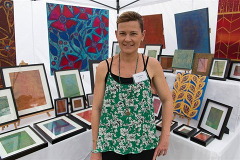 Artist Kathleen Rhee with some of her work