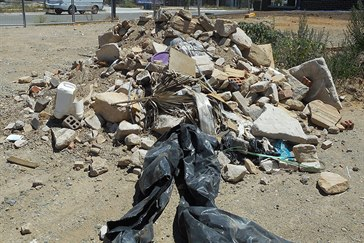 Illegally dumped building waste