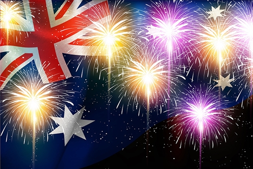 Image of fireworks over an Australian flag
