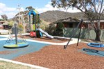 Banksia Park showing basket swing, climbing frame and slide