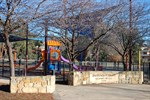 Baracks Flat Neighbourhood Park showing fenced playground with shade sails