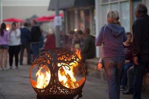 Steel fire pit alight in Blacksmiths Lane Queanbeyan during the laneway activation event